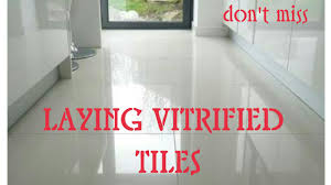 laying vitrified tiles on floor step by step procedure