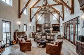 Huge Rustic Living Room With Massive Wood Beams Furniture And Large Stone Fireplace