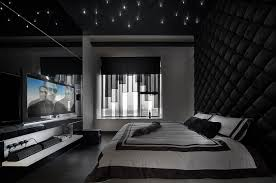 View In Gallery Stunning Bedroom Black With Tufted Wall Ceiling LED Inserts And An Expansive Entertainment Unit
