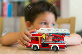 Young Boy Playing With Lego City Fire Truck On A Wooden Table ... Amazoncom Lego City Fire Truck 60002 Toys Games Lego 7239 I Brick Station 60004 With Helicopter Engine Ladder 60107 Sets Legocom For Kids My 4x4 Building Set Ages 5 12 Shared By Fire Truck Other On Carousell Man Lot 4209 7206 7942 4208 60003 Young Boy Playing With A Wooden Table City Fire Ladder Truck Brubit