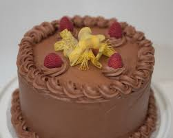 Double chocolate cake with raspberries fresh flowers not included