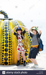 Yayoi Kusama Pumpkin Sculpture by Two Girls And A Pumpkin Sculpture By The Avant Garde Octogenarian