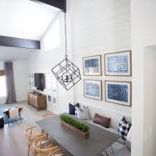 Aerial Dining Room View Featuring Cube Chandelier Over Sleek Gray Table With Built In Bench Seating