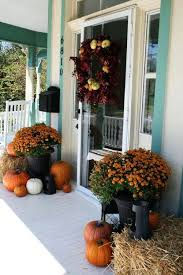 Hay Mums And Pumpkins For A Rustic Fall Porch