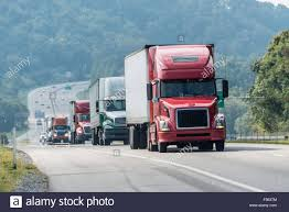 Semi-Trucks On The Highway Stock Photo: 89259876 - Alamy Why Walmarts Wmt Ceo Is Excited About His Order Of New Tesla Anheerbusch Orders 800 Hydrogenelectric Semi Trucks From Big Rigs Semi Trucks Different Colors Stock Photo Edit Now Teslas Electric Are Priced To Compete At 1500 The Any Love For One Our New Heavyhaul Rigs Peterbilt Old Truck Pictures Classic Galleries Free Download Sale In Ga On Craigslist Fresh Global Food Distributor Will Add 50 Its Fleet Semi Sign Store Nm How We Shipped The 600lb Navistar Blade Waymos Selfdriving Tech Spreads Slashgear In A Row 23554577 Alamy