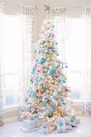 9 Ft Flocked Pre Lit Christmas Tree by Cool Toned Christmas Living Room Hayneedle Blog