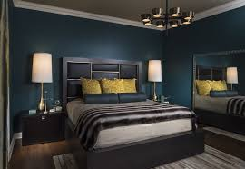 blue green walls with gold accents modern glam bedroom