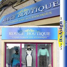 County Louth Sign Makers Work Above Door Of Fashion Boutique