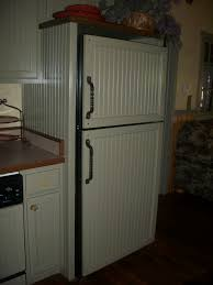 Primitive Kitchen Ideas Pinterest by Covering The Black Refrigerator With Wainscoting Panels To Lighten