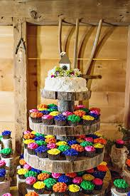 Wedding Cake With Tiers Of Colorful Cupcakes Barn Rustic