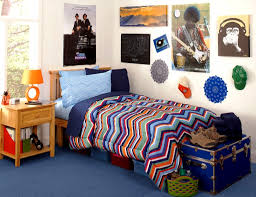 Mesmerizing Dorm Room Door Decorating Ideas For Small With Colorful Stripped Patterned Blanket Posters Table Lamp Chest And Blue Carpet Essentials In Guys
