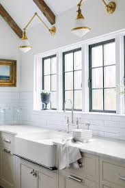 white glass and brass swing arm kitchen sconces transitional
