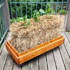 12 DIY Planter Boxes You Can Make In A Day Plants Straw Bale