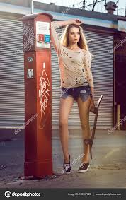 beautiful young with long legs wearing street style