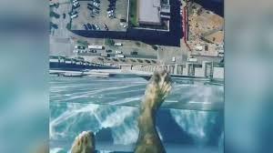 Swimming Over The Edge In Glass Bottom Pool 40 Floors High