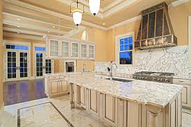 Marble Flooring Countertop Backsplash Cream Cabinets And Island Gas Range Vent Hood Undermount Sink