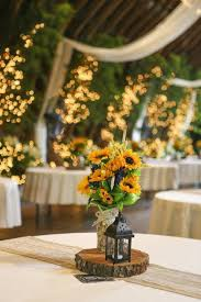 A Rustic Wedding With Beautiful Barn And Sunflower Theme Centerpiece