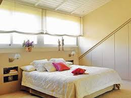 This Attic Bedroom Looks Very Bright And Airy View