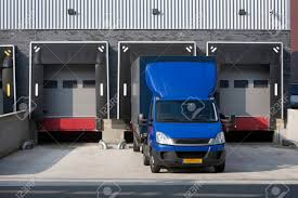 Warehouse Loading Dock And A Blue Truck Stock Photo, Picture And ... Home Nova Technology Loading Dock Equipment Installation Lifetime Warranty Tommy Gate Railgate Series Dockfriendly Mson Tnt Design The Determine Door Sizes Blue Truck At Image Scenario Cpe Rources Dock With Truck Bays In Back Of Store Stock Photo Ultimate Semi Back Up Into Safely Reverse Drive On Emsworth Ptoons And Floating Platforms Inflatable Shelter Stertil Products Freight Semi Trucks Cacola Logo Loading Or Unloading At