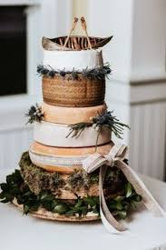 Cheese Wheel Rustic Wedding Cake With Canoe And Paddle Topper