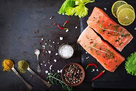 Download Raw Salmon Fillet And Ingredients For Cooking On A Dark Background In Rustic Style