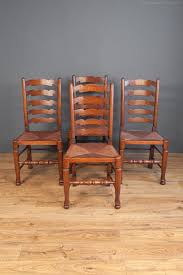 Antiques Atlas - Set Of Four Rush Seat Wavy Ladder Back Chairs 6 Ladder Back Chairs In Great Boughton For 9000 Sale Birch Ladder Back Rush Seated Rocking Chair Antiques Atlas Childs Highchair Ladderback Childs Highchair Machine Age New Englands Largest Selection Of Mid20th French Country Style Seat Side By Hickory Amina Arm Weathered Oak Lot 67 Set Of Eight Lancashire Ladderback Chairs Jonathan Charles Ding Room Dark With Qj494218sctdo Walter E Smithe Fniture Design A 19th Century Walnut High Chair With A Stickley Rush Weave Cape Ann Vintage Green Painted