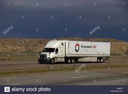 A White Freightliner Semi-Truck Pulls A White