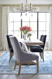 Dumont Dining Table Black Tufted Chairs Vintage Inspired Blue Rug Transitonal Modern Room