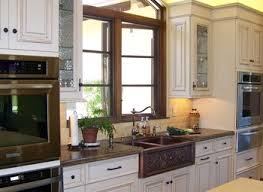 american woodmark cabinets kitchen traditional with hammered sink