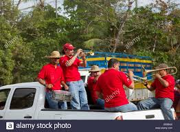 100 Truck Band Playing In The Back Of A Pickup Truck During The Tope De Stock