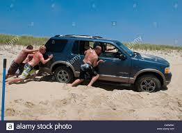 100 Stuck Truck Men Push A Stuck Truck On The Beach On Nantucket Island Stock Photo