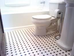 black bathroom shelf black and white tile floor vintage black and