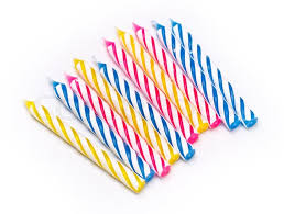 Some striped birthday candles on white background Stock