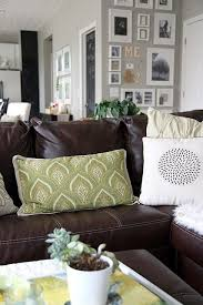 Brown Couch Decor Living Room by Lightening Up A Dark Leather Sofa2 Paint Color Is Valspar Bonsai