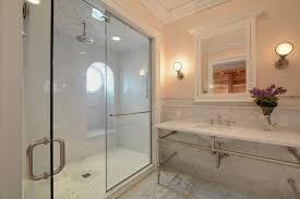 traditional master bathroom with wall sconce glass panel