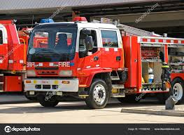 100 Red Fire Trucks And White Fire Trucks Ready For Action Stock Photo
