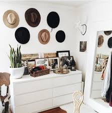Dressing Corner With Full Length Floor Mirror And Hats On Wall As Art Urbanoutfitters