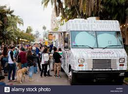 People Lining Up At The Devilicious Food Truck At The