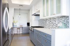 mid century modern kitchen in white and mosaic glass tile