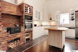 White Kitchen Decoration With Exposed Brick Wall Plus Built In Appliances And Wooden Islands
