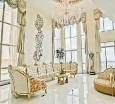 living room with large chandelier high ceiling lighting of