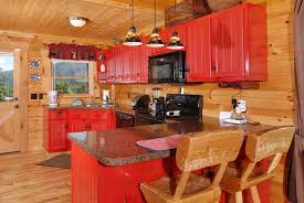 Log Cabin Kitchen Backsplash Ideas by Red Cabinetry Ads Fun And Color To This Log Cabin Kitchen