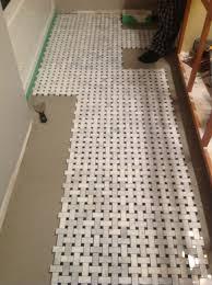 Tile Flooring Ideas For Bathroom by Bathroom Tile Floor Ideas Grey Porcelain Rectangle Floor Tiles