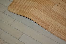 A Light Coloured Wood Floor With Looking Squishy Mat Lying On