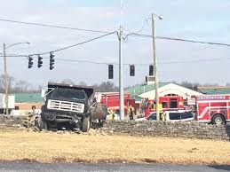 Dump Truck Plows Through Cars, Fence | News | News-graphic.com