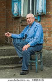 grandma sitting yellow chair stock photo 378685969 shutterstock