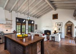 Rustic Kitchen With Stone Wall Fireplace And Wood Beam Ceiling Contemporary Spanish Style