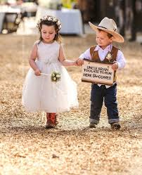A Young Flower Girl And Sign Bearer Coming Down The Aisle Magic Wand