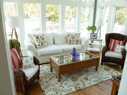Awesome White Themed Sunroom Design With Unique Twin Rattan Chairs Complete The Cushions And Rectangle Wooden Table On Rug Also Soft Sofa