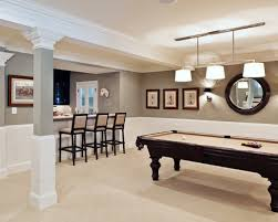 spacious basement family gathering with light brown wall paint